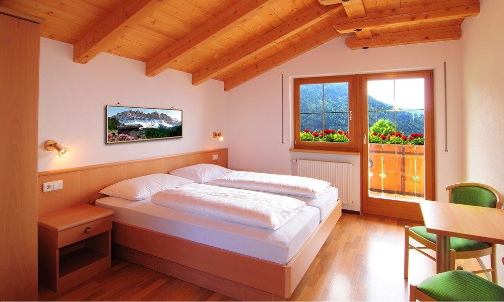 Come sono arredate le stanze dell'alloggio a Bressanone/ Plose?